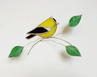 Bright yellow American Goldfinch stained glass bird on a wire branch with green leaves 3 dimentional suncatcher