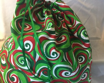 """Christmas Fabric Gift Bag  Eco Friendly Drawstring Bag----Reuseable size 17"""" wide x 16"""" tall  Red and Green Swirls"""