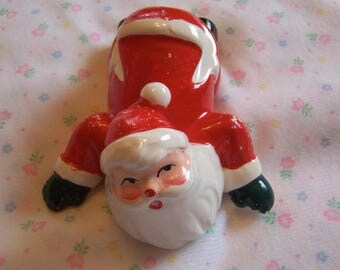 brinn's adorable crawling santa figurine