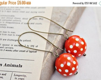 Sale vintage polka dot orange earrings.