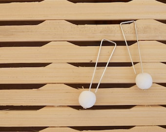 Delicate silver drop earrings with 10mm solid snow white resin bead.