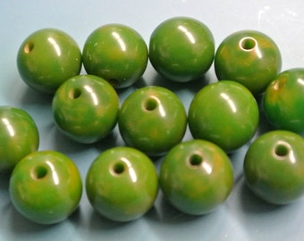 Lot of 13 vintage 1940s unused opaque round flamy dark grass green and slightly mustard yellow tested bakelite beads