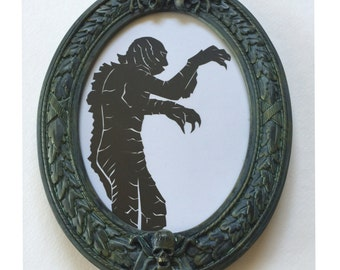The Gill Man from Creature From the Black Lagoon Silhouette in REAL Haunted Mansion Theme Park Frame