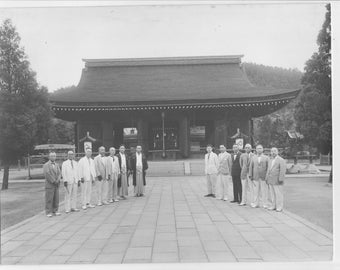 Vintage Japan photo  a black and white photo of a group of Japanese men in front of a building