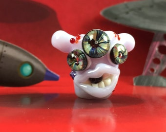 Three eyed grinning dreadlock creeper bead