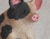 running spotted pig in high fired rugged rustic stoneware