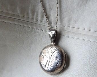 antique round locket sterling silver etched leaf