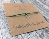Lucky Charm.  Sterling Silver Hand Stamped Four Leaf Clover Bracelet on Cord. Irish luck.