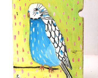 Painting on reclaimed wood of a blue budgie