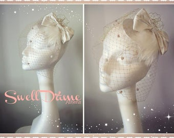 Swell Dame vintage style fascinator with bow  and veiling