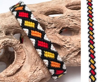 Friendship bracelet - embroidery floss - tilted rectangles - orange, red, & yellow - bright - knotted - woven - macrame - thread