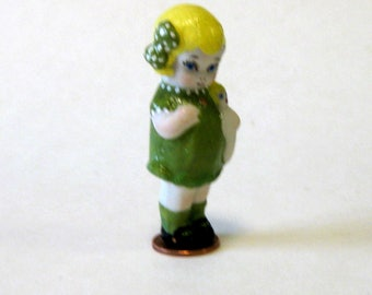 "porcelain handcrafted 2 1/2"" penny doll holding her doll"