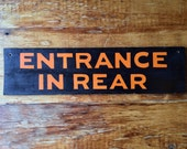 Vintage 1950s Entrance in rear sign for a shop warehouse restaurant bar man cave