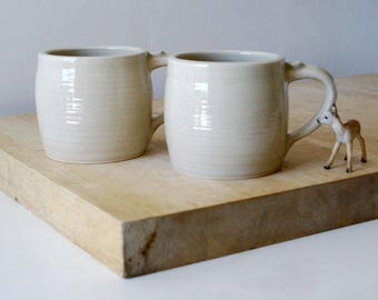 Two tankard style stoneware pottery tea mugs - glazed in simply clay