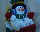 Bucilla Felt SNOWMAN on TABOGGEN CHRISTMAS Ornament from the Winter Fun Collection
