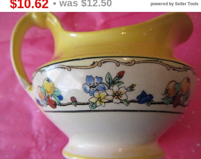 Hampton Ivory England Creamer / Gravy Pitcher Lovely Design done With Wide Rim of Yellow Over Delicate Floral Pattern