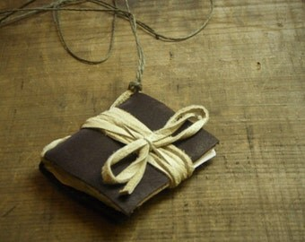 The Bounty Hunter's Ledger. Handmade Chocolate leather mini journal buckskin binding sage green hemp necklace. Organic Unique Gift idea