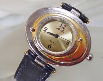 SALE Vintage Moulin Mod Ladies Watch. Gold and Silver Tone. Atomic Age.  Water Resistant. Black Leather Band.