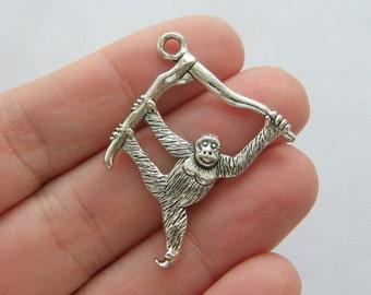 4 Orangutan pendants antique silver tone A133
