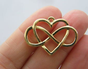 4 Infinity heart charms gold tone GC69