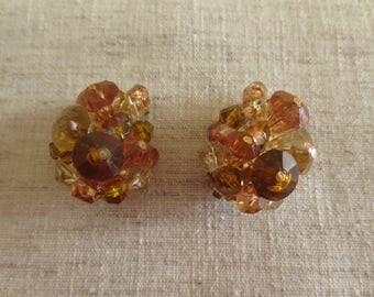 Vintage beautiful made in Germany golden brown plastic crystal bead tear drop design gold tone clip on earrings . 1 pair of earrings.