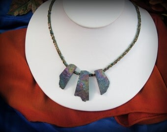 Dramatic multi-stone pendant necklace in purples, blues and brass tones