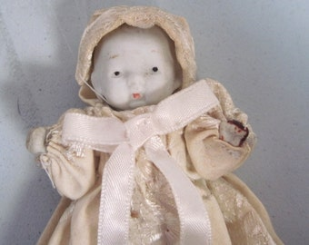 Vintage miniature porcelain baby doll with long embroidered gown