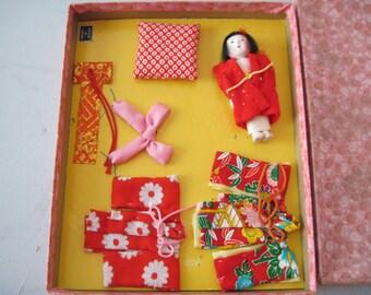 Miniature Gofun Geisha Doll with obi and two kimonos