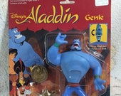 10% OFF 1993 Disney Aladdin Genie with Flip Changing Head Action Figure - New on Card