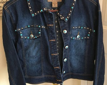 "A ""Don't Mess with Texas"" Denim jacket with  silver and turquoise cross embellishment"