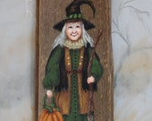 """Carly and her Pumpkin, Halloween witch, Ozarks barnwood, hand painted, 5 1/2"""" x 12"""""""