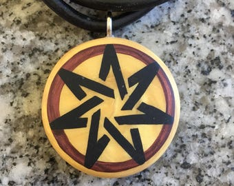 7 Pointed Heptagram black Fairy Star hand carved on a polymer clay light gold color background. Pendant comes with a FREE necklace