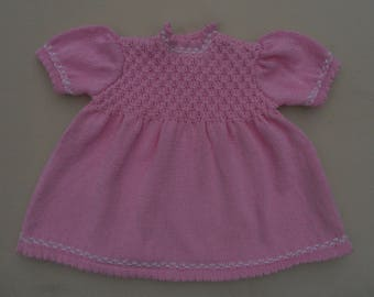 Baby girl's dress age 12 months, chest 20/21 in. Pure cotton, hand knitted from a vintage pattern, smocked bodice.  Pretty pink for summer!