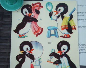 Vintage decorators Decals. Penguins Getting Cleaned Up. Sheet With 4 Individual Scenes. Drying, Hair Combing, Shaving and Teeth Brishing.
