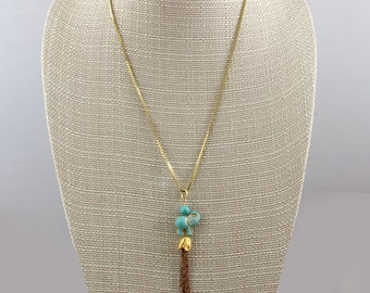 This Handmade Elephant Balancing a Turquoise Ball Sits on a Tulip Spewing A Chain Tassel 24 inch Box Chain