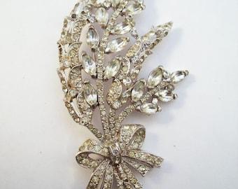 Coro glitzy rhinestone flower bouquet brooch from 1941