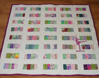 Youth Quilt with a ballerina in fuchsia  silhouette appliquéd on the front, perfect for some little girl.