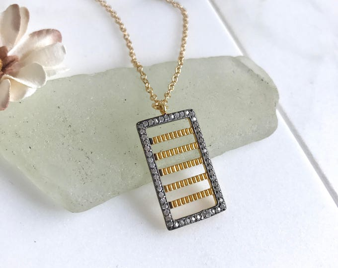 Unique Bar Pendant Necklace with Cubic Zirconia in Gold.