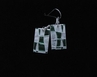 Rectangular, silver, dangle earrings with emerald green faux enameling highlights.