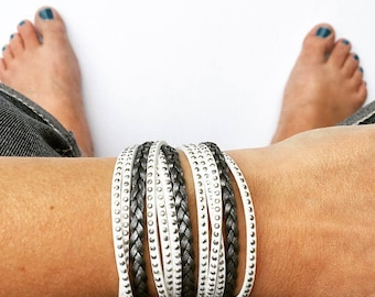 triple wrap bracelet in silver braided leather and white suede with silver accents. lobster clasp with heart drop. Bohemian jewlery.