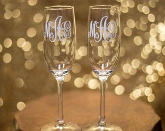 Bride and Groom toasting flutes, Wedding champagne glasses personalized with Monogram.  Engagement gift idea