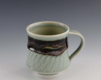 Wheel-thrown Porcelain Mug with Celadon and Tenmoku Glazes and Chattering decoration by Hsinchuen Lin 林新春