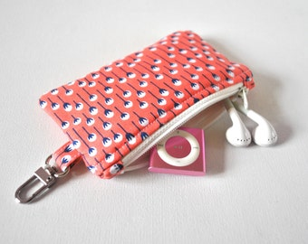Woman's floral key chain coin pouch padded gadget change purse in coral pink and white dandelion flower print.