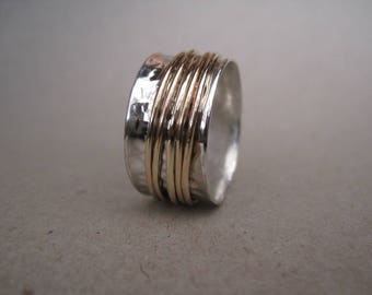 Sterling silver and yellow gold spinning ring - made to order