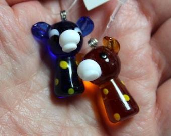 Two Czech glass pendants. Cobalt blue and amber giraffes