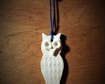 White Owl ornament with blue ribbon. White ornament will really show up on tree, present or wreath