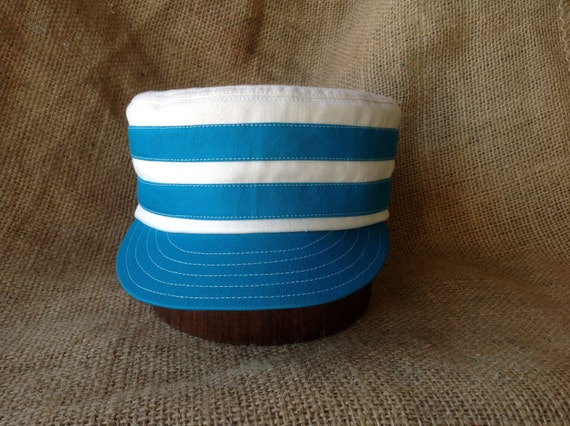 "Natural cotton twill boxcap with cotton teal bands, 2"" visor, cap made to any size. Cotton sweatband."