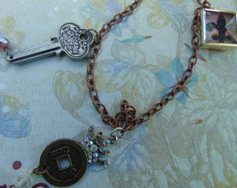 Copper Steampunk Necklace with Key, Crown, And Picture Charms