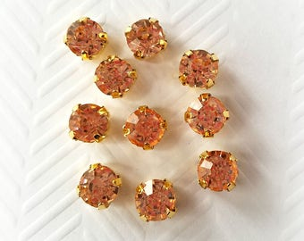8mm Sew On Peach Glass Rhinestones. 10 Pieces.