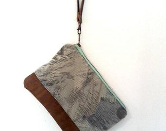 Abstract print wristlet with detachable wrist strap. Distressed brown leather and smooth corduroy, green and gray tone fabric. Ready to ship